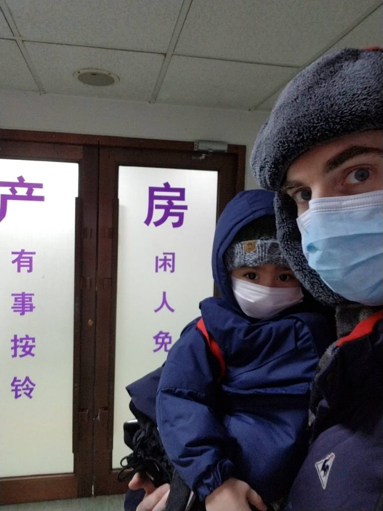 Jason in mask with father Chris in Dalian February 2019